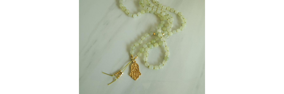 Jade mala necklace with hamsa hand
